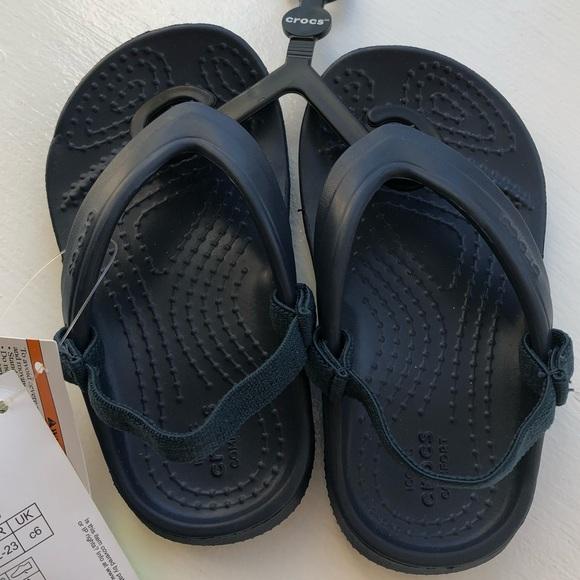 549589651cb486 Toddler child s crocs navy blue flip flops